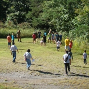 Families following activity leaders to site