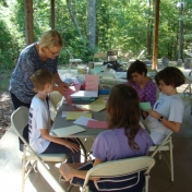 Children involved in a nature art project