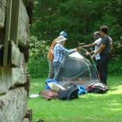Working on Setting Up Tent